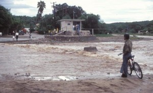Man watching flood waters. Alamos, Sonora, Mexico. Photo by Anders Tomlinson.