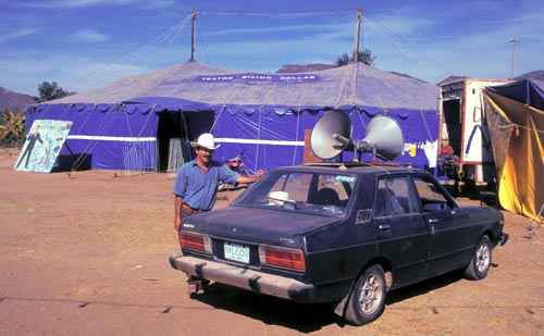 A traveling hypnotist sets up his blue tent in Alamos, Sonora, Mexico.  Photo by Anders Tomlinson.