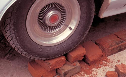 Bricks used as a car jack, Alamos, Sonora, Mexico.  Photo by Anders Tomlinson.