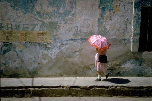 Woman with umbrella walking in Alamos, Sonora, Mexico.  Photo by Anders Tomlinson.