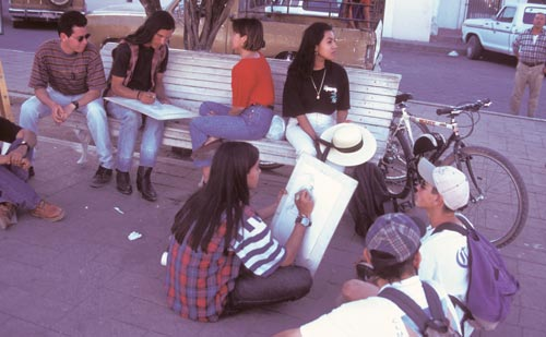 young artists sketch on the plaza, Alamos, Sonora, Mexico.  Photo by Anders Tomlinson.