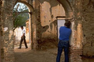 Gary Ruble photgraphing passerby from a ruin in Alamos, Sonora, Mexico. Photo by Anders Tomlinson.