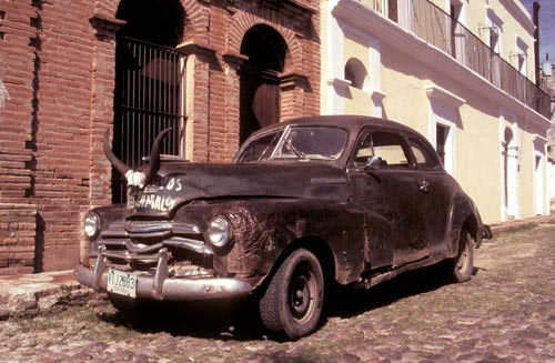 Old car with horns on the hood, Alamos, Sonora, Mexico.  Photo by Anders Tomlinson.