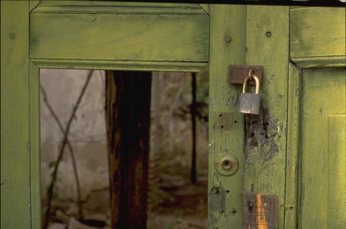 Green door and lock at ruin site, Alamos, Sonora, Mexico.  Photo by Anders Tomlinson