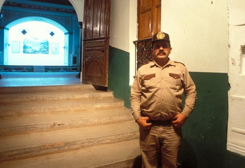 Policeman guarding the Palacio at night.  Alamos, Sonora, Mexico.  Photo by Anders Tomlinson.