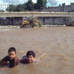 Two boys playing in flood water, Alamos, Sonora, Mexico. Photo by Anders Tomlinson.