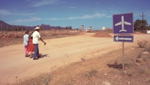 family walking by airport on the outskirts of town, Alamos, Sonora, Mexico. Photo by Anders Tomlinson.