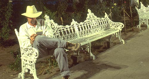 Anders Tomlinson on Plaza bench in Alamos, Sonora, Mexico.  Photo by Antonio Figueroa.