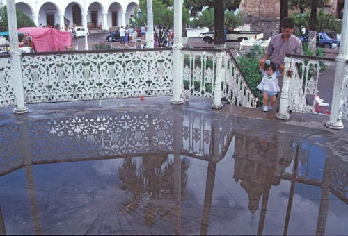 Church reflection on a wet Plaza kiosk floor, Alamos, Sonora, Mexico.  Photo by Anders Tomlinson.