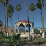 Sierra de Alamos, Bishop Reyes Cathedral, Plaza de Las Armas garden and kiosk and Hotel Los Portales. Alamos, Sonora, Mexico. Photo by Anders Tomlinson.