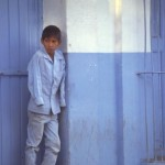 Boy waiting for work to open up, Alamos, Sonora, Mexico. Photo by Anders Tomlinson.
