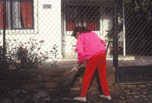 Girl in barrio sweeping in front of her house, Alamos, Sonora, Mexico. Photo by Anders Tomlinson.