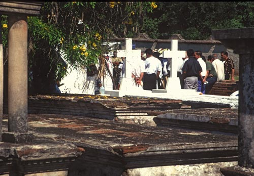 Priests and service in graveyard, Alamos, Sonora, Mexico.  Photo by Anders Tomlinson.