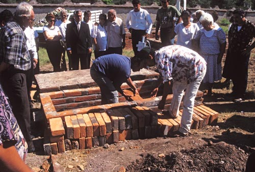 Bricks are laid over the casket, Alamos, Sonora, Mexico.  Photo by Anders Tomlinson.