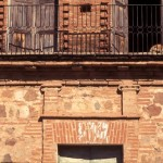 Detail with sleeping pup, red-brick building on Calle Cardenas, Alamos, Sonora, Mexico. Photo by Anders Tomlinson.