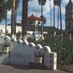 Plaza de las Armas, bandstand-kiosk, Bishop Reyes' Cathedral. Old Alamos Hotel, and the Mirador. Alamos. Sonora, Mexico. Photo by Anders Tomlinson.
