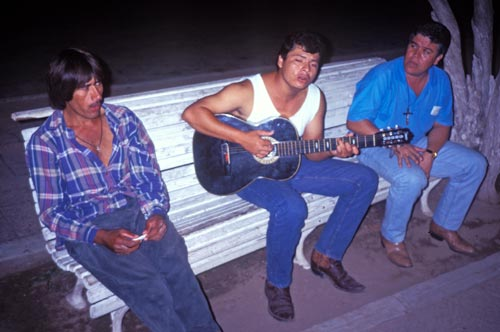 Three men in the plaza singing on a summer night, Al;amos, Sonora, Mexico. Photo by Anders Tomlinson.