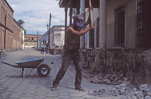 Man breaking up street, Calle Rosales, Alamos, Sonora, Mexico.  Photo by Anders Tomlinson.