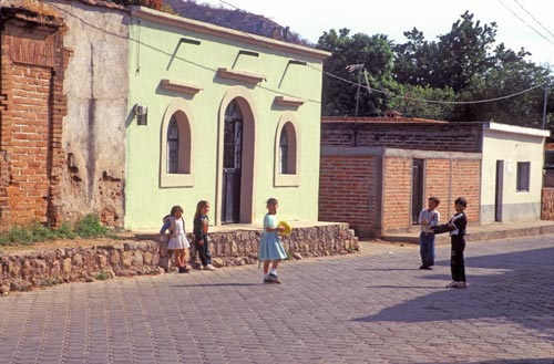 Small kids playing with a ball on Calle Aquiles Serdan, Alamos, Sonora, Mexico. Photo by Anders Tomliinson.