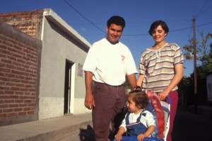 Alamos photographer Antonio Figueroa, wife and daughter outside his home. Alamos, Sonora, Mexico. Photo by Anders Tmlinson