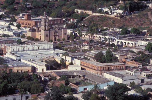 Plaza de las Armas, Bishop Reyes Cathedral, the Palacio are all seen from Red Cross hill.  Alamos, Sonora, Mexico.