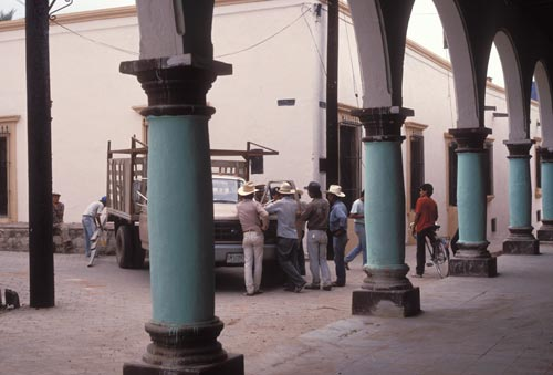 Construction crew working on Calle Allende talk about pay checks, Alamos, Sonora, Mexico.  Photo by Anders Tomlinson.