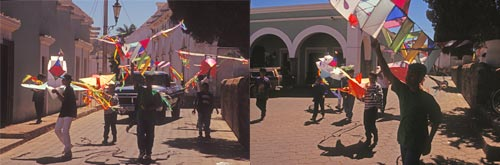Participants in the kite flying contest parade through the town on their way to and from El Mirador, Alamos, Sonora, Mexico. Photo by Anders Tomlinson.