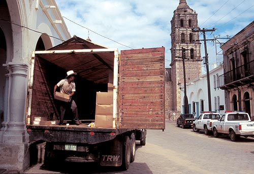 aid truck is being loaded up on calle comercio. alamos sonora mexico.  photo byt anders tomlinson