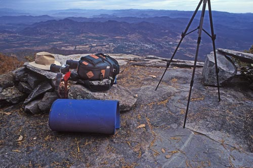 Anders Tomlinson camera gear atop Sierra de Álamos' Gringo Point looking down at Álamos, Sonora, Mexico.  Photo by Anders Tomlinson.  Spring 1995.