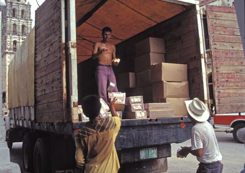 Conasupo trucking loading up food and supplies for neighboring towns, alamos, sonora, mexico.  photo by anders tomlinson.