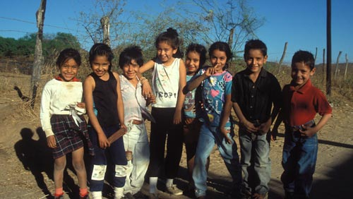 kids gather for photo on old el camino real,  near the airport, alamos, sonora, mexico. photo by anders tomlinson.