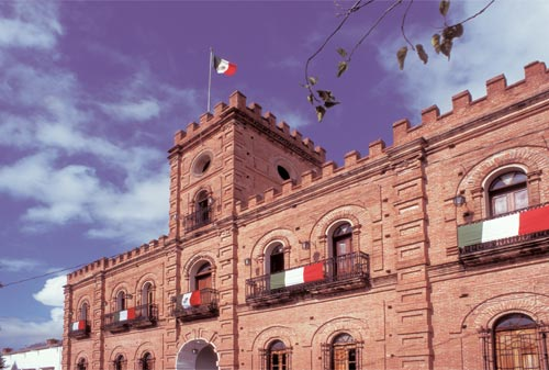 palacio municipal of alamos, sonora, mexico is decked out in bunting celebrating independance day.  photo by anders tomlinson.