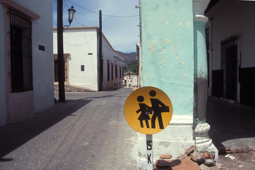 Student crossing sign outside lementarty school in Centro Alamos.  Alamos, Sonora, Mexico.  Photo by Anders Tomlinson.