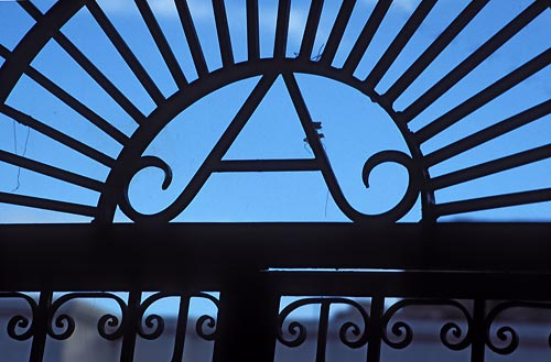 An A stands for Alamada over a gate on Calle comercio, in alamos, sonora, mexico.  photo by anders tomlinson