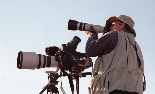 Anders Tomlinson with cameras in the Tule Lake Basin.  Photo by Jeff Ritter.  2006